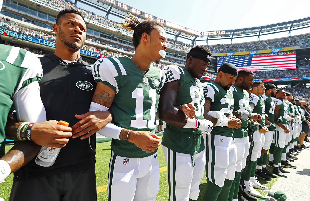 New York Jets stand in unison during National Anthem prior to an NFL game against the Miami Dolphins at MetLife Stadium on September 24, 2017