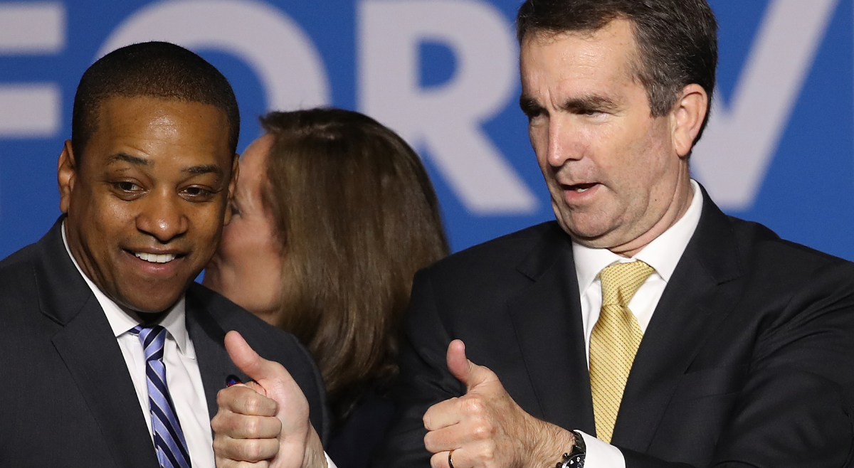 Gov.-elect Ralph Northam and Lt. Gov.-elect Justin Fairfax greet supporters at an election night rally November 7, 2017 in Fairfax, Virginia.