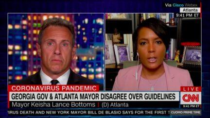 Covid-positive Atlanta Mayor Keisha Lance Bottoms blasts Georgia Governor Brian Kemp's 'baffling' response to surging pandemic numbers