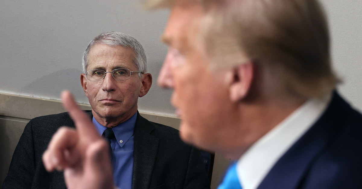 WASHINGTON, DC - APRIL 07: Anthony Fauci, director of the National Institute of Allergy and Infectious Diseases, listens to U.S. President Donald Trump speak to reporters following a meeting of the coronavirus task force in the Brady Press Briefing Room at the White House on April 7, 2020 in Washington, DC. The president today removed the independent chairman of a committee tasked with overseeing the roll out of the $2 trillion coronavirus bailout package. (Photo by Chip Somodevilla/Getty Images)