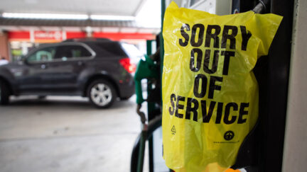 An Out Of Service bag covers a gas pump as cars continue line up for the chance to fill their gas tanks at a Circle K near uptown Charlotte, North Carolina on May 11, 2021 following a ransomware attack that shut down the Colonial Pipeline.