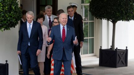 US President Joe Biden walks out of the White House with a group of US Senators after a meeting on infrastructure negotiations on June 24, 2021 in Washington, DC. - Biden announced he has reached a deal with the bipartisan group of senators on a landmark infrastructure package, likely the most funding for roads, bridges and ports in decades. (Photo by Jim WATSON / AFP) (Photo by JIM WATSON/AFP via Getty Images)