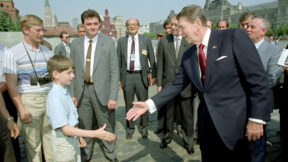 Ronald Reagan shakes hand with young boy in Red Square, Moscow