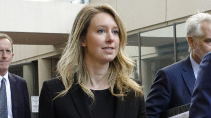 SAN JOSE, CA - JULY 17: Former Theranos CEO Elizabeth Holmes (C) leaves federal court with her legal team after a status hearing on July 17, 2019 in San Jose, California. Holmes is facing charges of conspiracy and wire fraud for allegedly engaging in a multimillion-dollar scheme to defraud investors with the Theranos blood testing lab services. (Photo by Kimberly White/Getty Images)