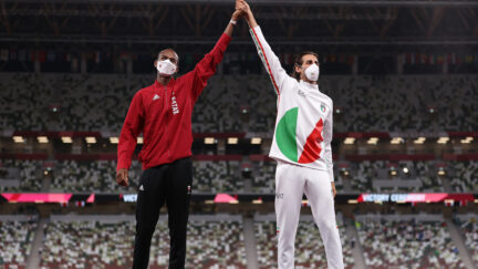 Joint gold medalists Mutaz Essa Barshim of Team Qatar and Gianmarco Tamberi of Team Italy celebrate on the podium during the medal ceremony for the Mens High Jump on day ten of the Tokyo 2020 Olympic Games at Olympic Stadium on August 02 2021 in Tokyo Japan.