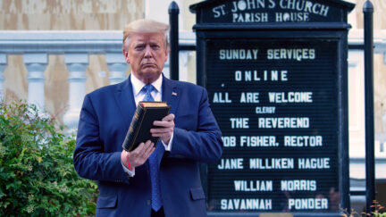 Donald Trump holds a Bible while visiting St. John's Church across from the White House after the area was cleared of people protesting the death of George Floyd