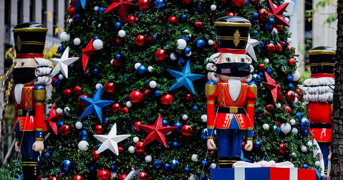 NEW YORK, NY - NOVEMBER 27: Nutcracker wearing protective masks are placed in front of a Christmas Tree at News Corporation on November 27, 2020 in New York, United States. Shoppers go out early despite ongoing concerns and limitations due to COVID-19 this year.